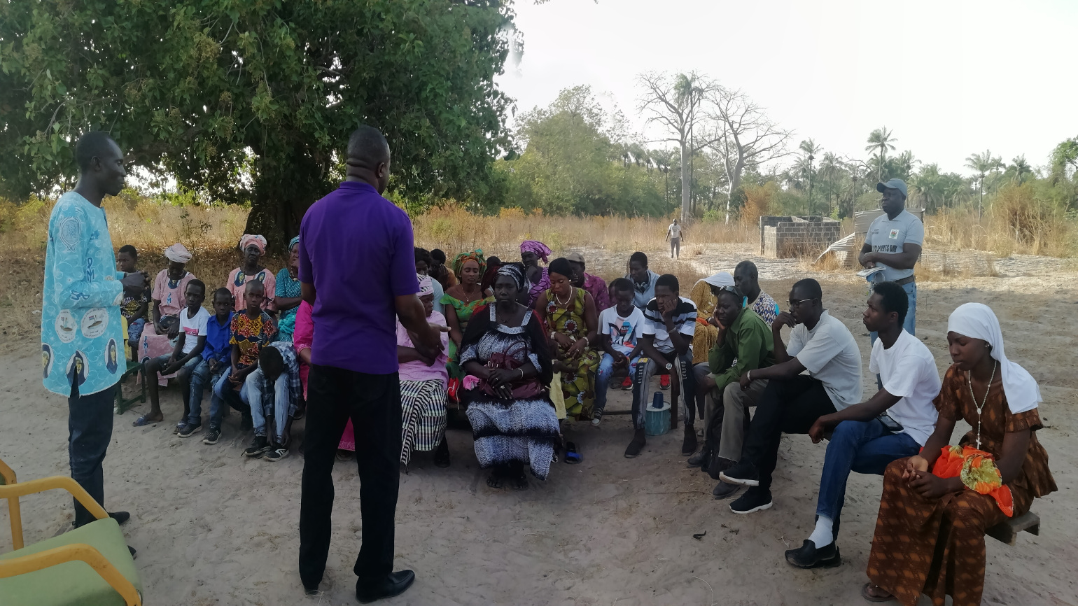 A picture of The GS having a workshop with the natives of Farabasuto